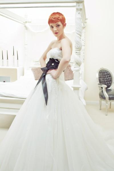 Base neckline long bodice, drop waist full multi layered tulle skirt wedding dress with lace bodice and full beading