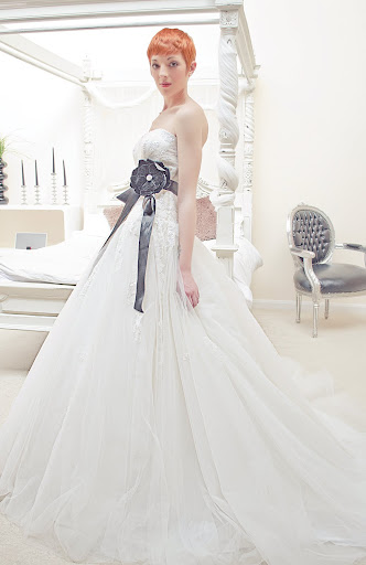 Base neckline long bodice, drop waist full multi layered tulle skirt wedding dress with lace bodice and full beading