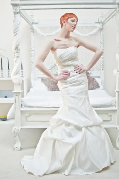 Strapless straight neckline ruched bodice duchess satin mermaid wedding dress with tucked skirt