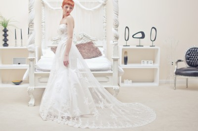 Lace and tulle dipped base neckline, fit and flare wedding dress with beautiful duchess satin mermaid wedding dress shaped lining. Absolutely stunning.