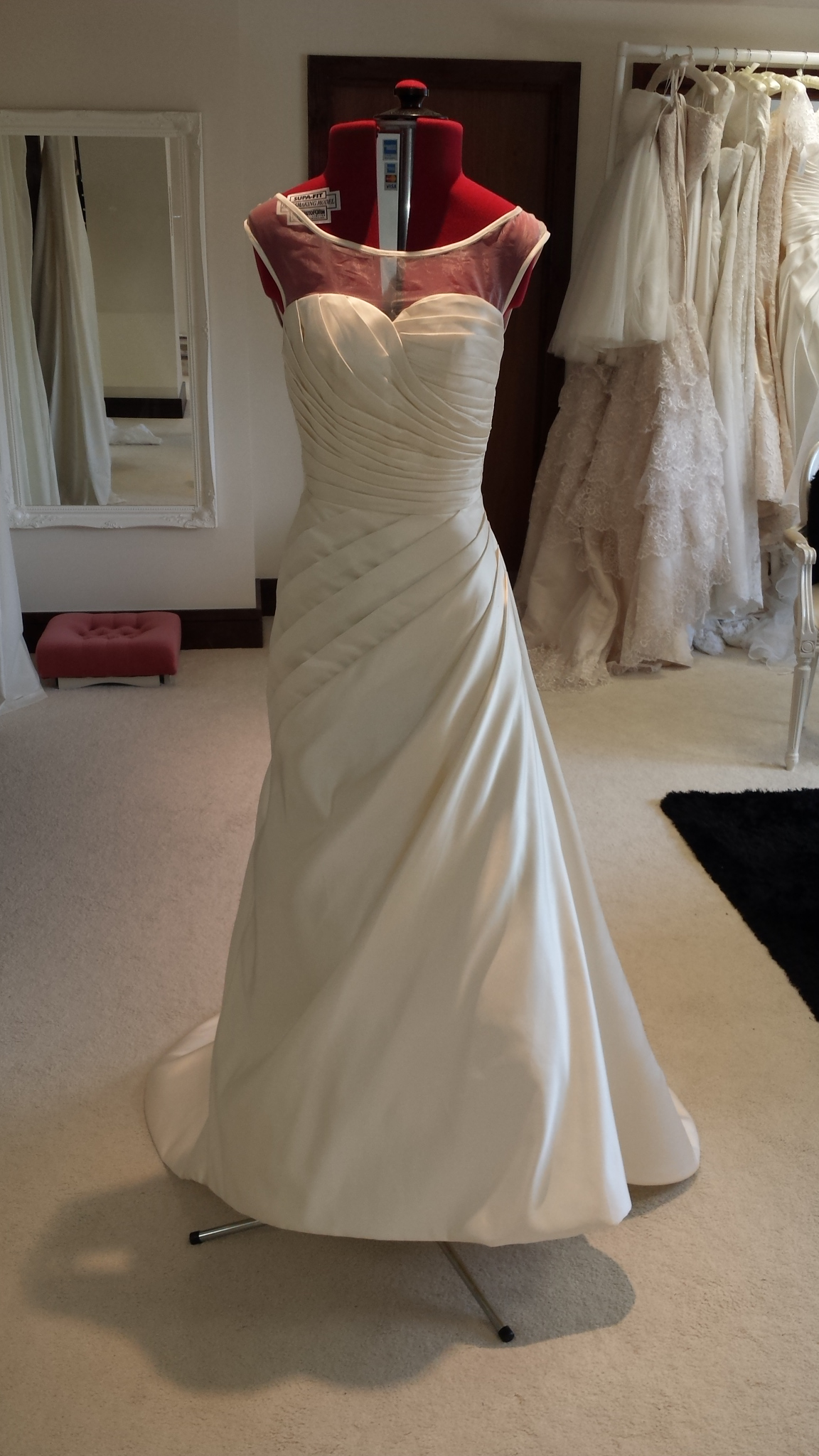 Illusion Neckline Wedding Dress with ruched bodice and A-Line Skirt with Long Train created in Ivory Satin Fabric
